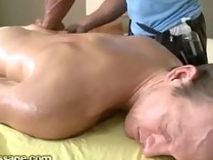 gay stiff muscular male gives massage