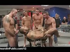 bound gay showered with cumshots in the middle of
