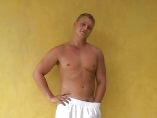 muscular bleached gay hunk jerks off his heavy