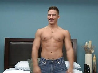 muscled gay sex star doing a striptease