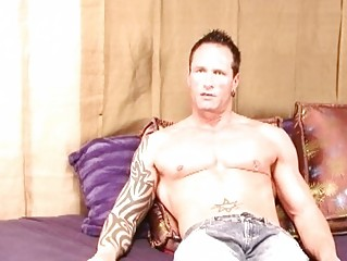stiff tattooed gay hunk jerks off his chubby meat
