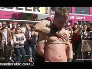 bound gays punished inside the streets at gay show