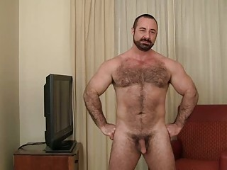 bearded gay bear goes naked into his living house