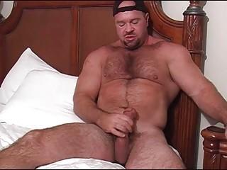 bearded gay bear jerks off his giant schlong