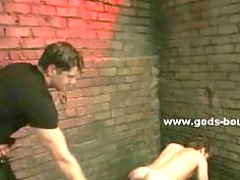 gay slave put into the corner inside bondage