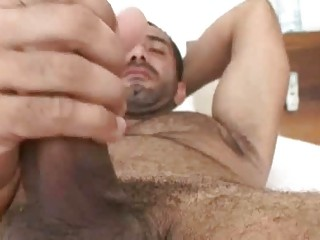 inflexible gay stud jerks off huge dong