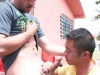 eastern  gay licking a uneasy  dick beside a fence
